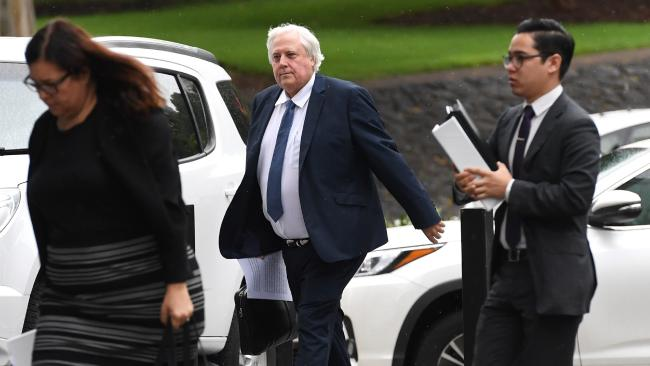 Businessman Clive Palmer (centre) arrives at the Supreme Court in Brisbane on Tuesday. Picture: AAP/Dan Peled