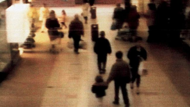James Bulger being led away by his killers Jon Venables and Robert Thompson. Picture: Supplied