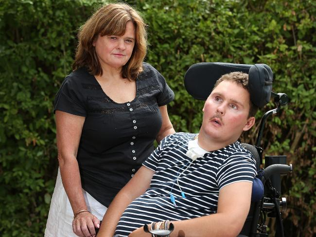 Sam (above, with mother Katie) now needs 24/7 care and his family are in debt after the NDIS slashed funding.