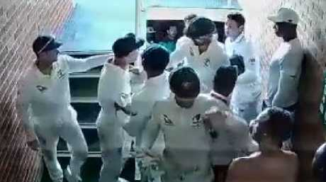 David Warner has to be restrained by his teammates.