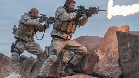 Chris Hemsworth, centre, in a scene from the movie 12 Strong.