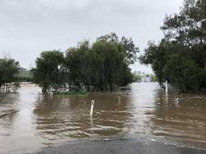 Water over road as rainfall swells creek system