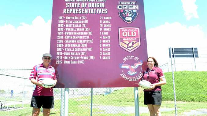 PROUD FUTURE: MJRL's Barry Blanchfield and Tina Faulkner in front of the league's Origin board.