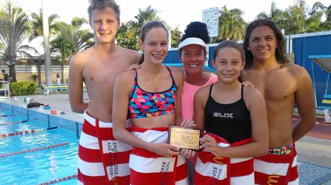 The Mackay Cyclone Swimming Club had 16 children compete in the NQChampionships over the weekend. (From left) Connor Burrows Age Champion 14 year old boys, Emily Ferreira Age Champion 14 year girls, Coach Leigh-Anne Pokarer, Anna Boxall Age Champion 10 year old girls and Adam Smit Age Champion 16 year old boys. Coach Leigh-Anne Pokarer holds the Jenny Logan Memorial Award they won at the event.