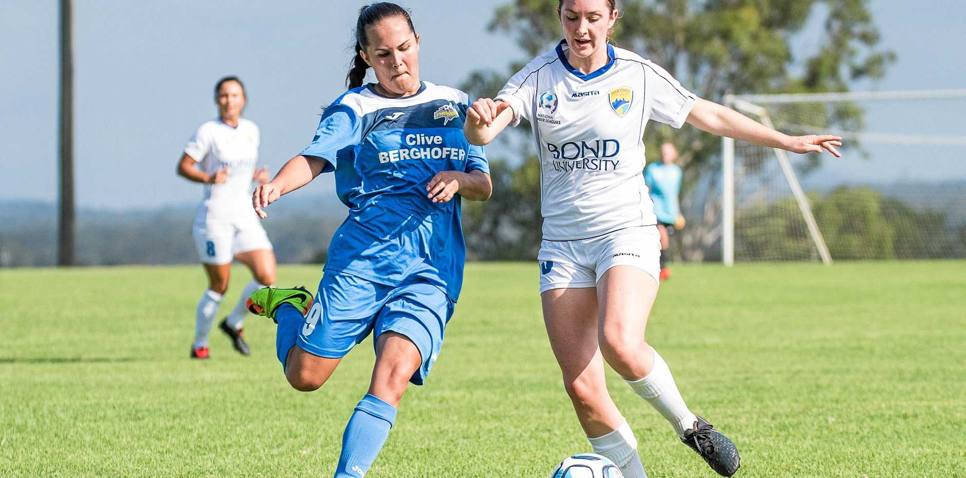 South West Queensland Thunder player Jess Fry (left) battles for possession of the ball.
