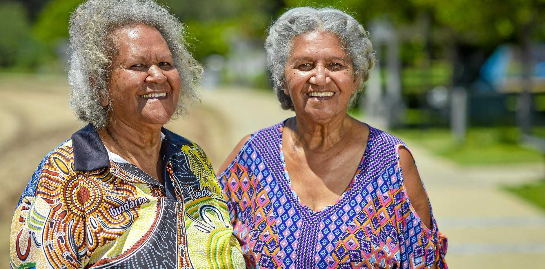 SISTERS IN ARMS: Retired teachers Neola Savage and Juliri Ingra says black and white people need to work together.