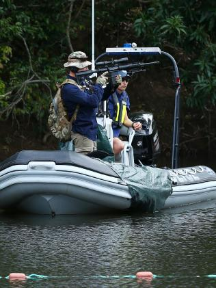 SERT officers with machine guns keep watch for crocodiles as police divers search Isabella Creek at Leggett's Crossing near Cooktown for the body of Donna Steele. Photographer: Liam Kidston.