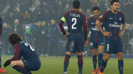 Paris Saint-Germain's players react after losing
