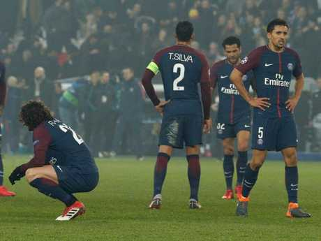 Paris Saint-Germain's players react after losing