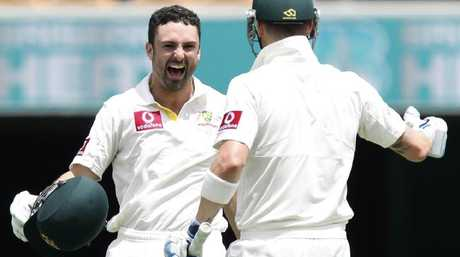 Ed Cowan, runs to his captain Michael Clarke as he reaches his lone Test century.