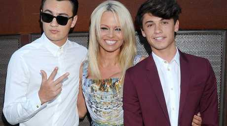 Pamela Anderson and sons Brandon (left) and Dylan (right). Picture: Gregg DeGuire/Getty Images