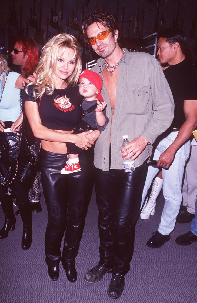 Pamela Anderson and Tommy Lee with baby Brandon. Picture: S Granitz/WireImage)