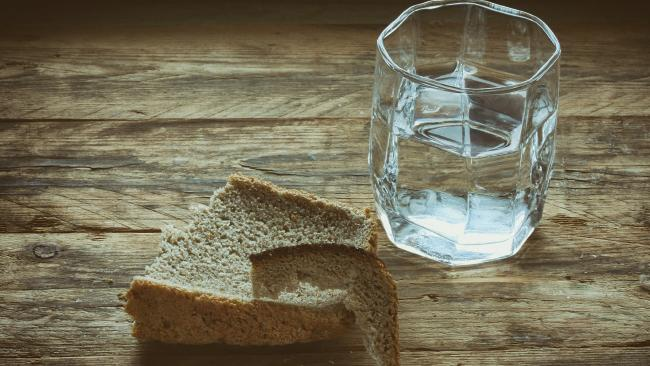 Running water over your loaf rehydrates the bread.