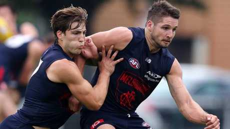 Jack Viney (left) competes with Jesse Hogan. Pic: Michael Klein