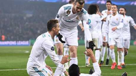 Real Madrid's Brazilian midfielder Casemiro (down) celebrates