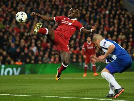 Sadio Mane of Liverpool stretches for the ball
