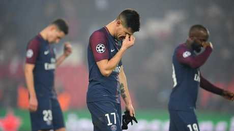 Yuri Berchiche of PSG (17) and team mates look dejected