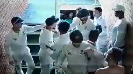 David Warner is restrained by teammates after an altercation in the run with Quinton de Kock.