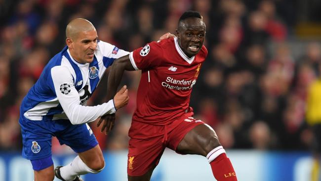 Sadio Mane of Liverpool is challenged by Maximiliano of FC Porto