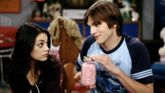 Mila Kunis and Ashton Kutcher on That '70s Show in 1998.
