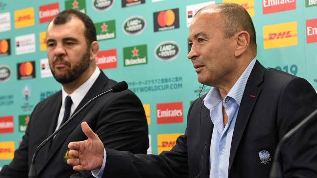 England coach Eddie Jones speaks beside Australia's Michael Cheika in Kyoto.