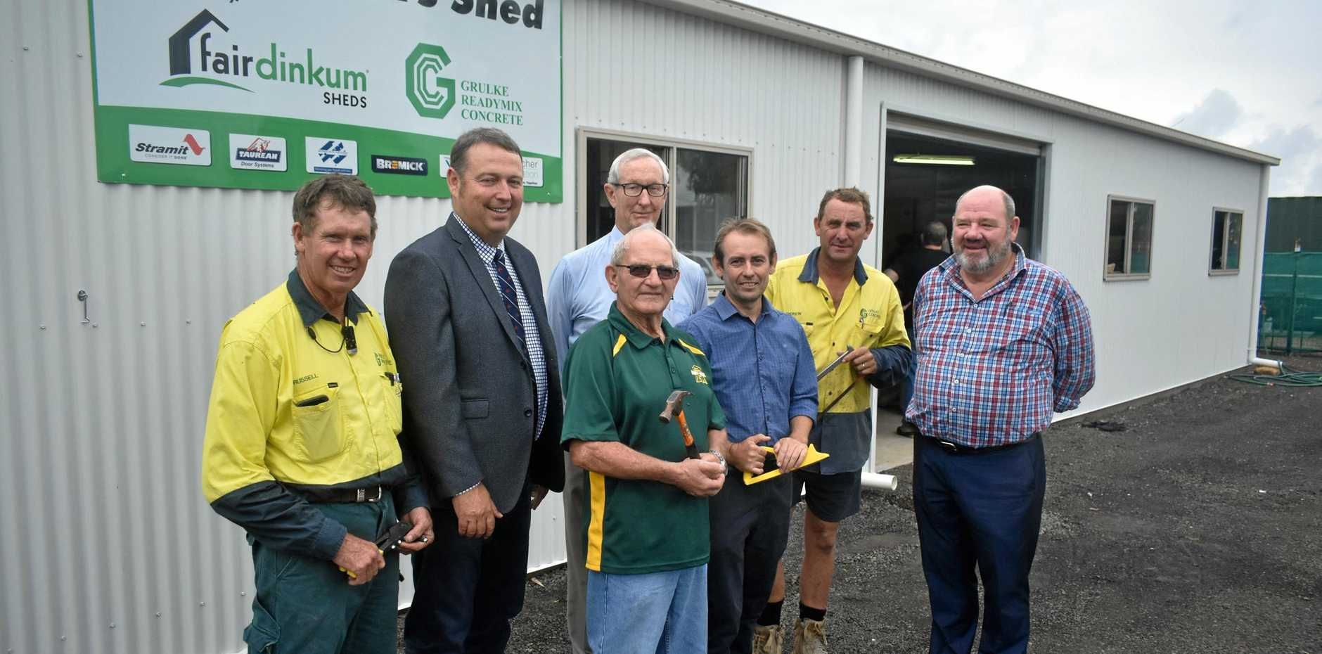 HAPPY MEN: Russell Grulke, Tyson Golder, Mick Stuhmcke, Bruce Scott, Kevin Chambers, Andrew Harvey and Michael Reddan at the opening of the Roma Men's Shed building.