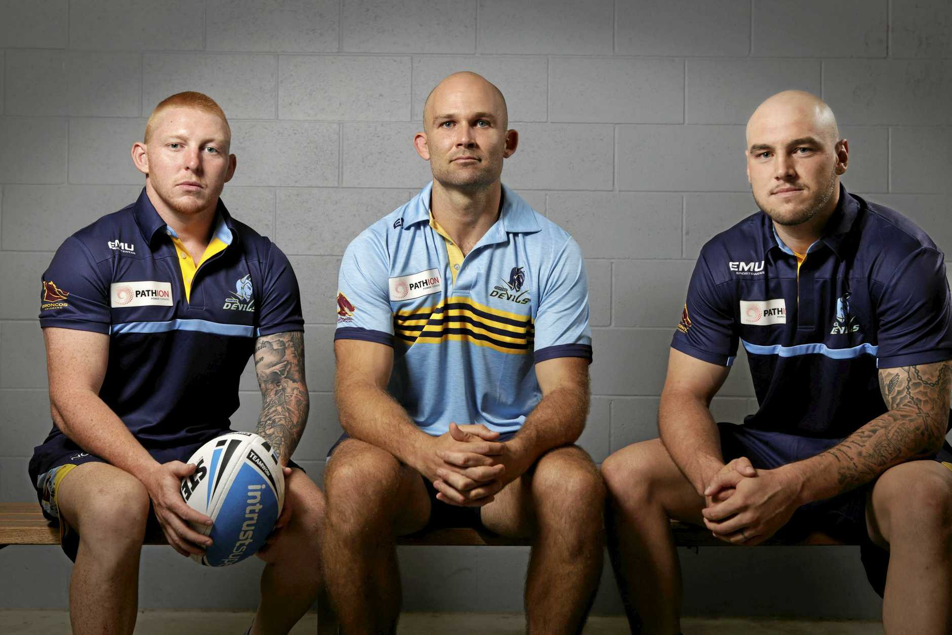 Norths coach Rohan Smith (centre) with new recruits Alex Bishop and Jack Ahearn.