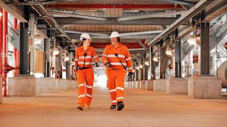 Australia Pacific LNG Project Engineer Kayla Billadeau and Operations Technican Trevor Dummett.