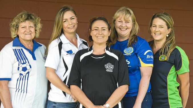 FOOTBALL EVOLUTION: Toowoomba Football League supporters and players (from left) Sue Bubeck, Shannon Tyrrell, Sharon Hill, Rebecca Willmot and Hana Paul love how much the female game has evolved and developed in recent years.