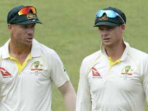 Warner slams coward's 'disgusting' wife sledge