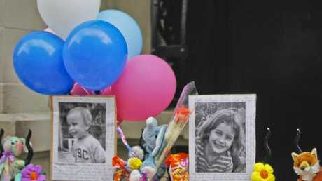 In this file photo, photographs of 6-year-old Lucia Krim and her 2-year-old brother, Leo, are displayed alongside balloons and stuffed animals outside the building where they lived. Picture: Mary Altaffer/AP