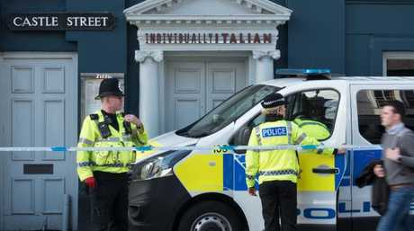 Police officers stand outside a branch of the Italian restaurant Zizzi where an ex-Russian spy and his daughter had dined before becoming ill. Picture: Getty Images