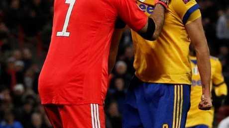 Juventus' Italian defender Giorgio Chiellini (R) reacts with Juventus' Italian goalkeeper Gianluigi Buffon (L)