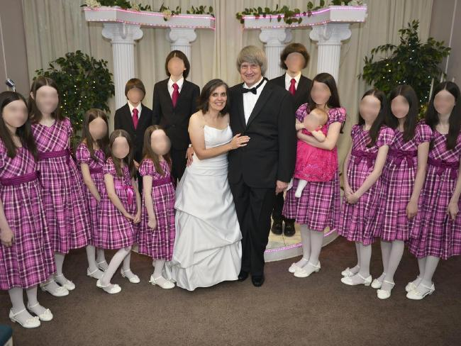 David Allen Turpin, 57, and Louise Anna Turpin, 49, pictured with their 13 children during one of their many wedding vow renewal ceremonies. Picture: Supplied