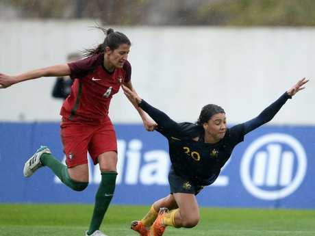 Sam Kerr of Australia competes for the ball with Silvia Rebelo of Portugal