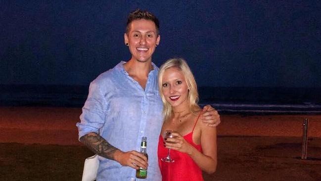 Jackson Parr and girlfriend posing for the romantic photo that ended up saving the life of a stranded swimmer. Picture: Facebook