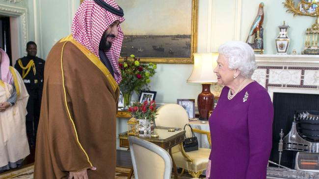 Britain's Queen Elizabeth II greets the Crown Prince of Saudi Arabia Mohammed bin Salman, during a private audience at Buckingham Palace in London, Wednesday March 7, 2018. (Dominic Lipinski/pool via AP)