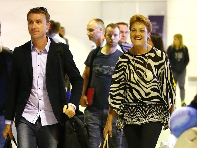 Pauline Hanson and adviser James Ashby arriving at Brisbane airport following the West Australian State election. Photographer: Liam Kidston.