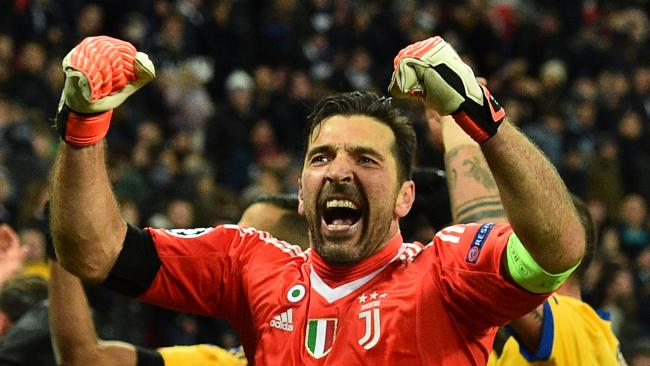 Juventus' Italian goalkeeper Gianluigi Buffon (C) celebrates