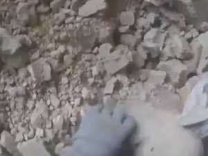 Baby rescued from bombed building