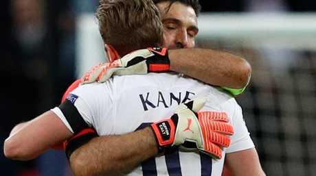 Juventus' Italian goalkeeper Gianluigi Buffon (L) embraces Tottenham Hotspur's English striker Harry Kane (R)