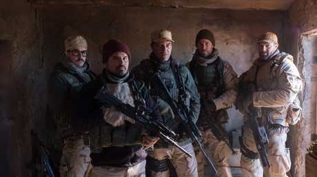 Ben O'Toole, Michael Pena, Michael Shannon, Chris Hemsworth and Geoff Stuits in a scene from 12 Strong.