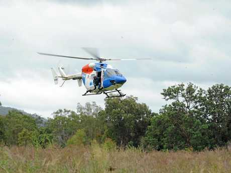 SEARCH TEAM: The AGL rescue helicopter lifts off for another sweep of the surrounding bushland in the search for missing motorcyclist Paul Stevenson. Photo: Mike Knott / NewsMail