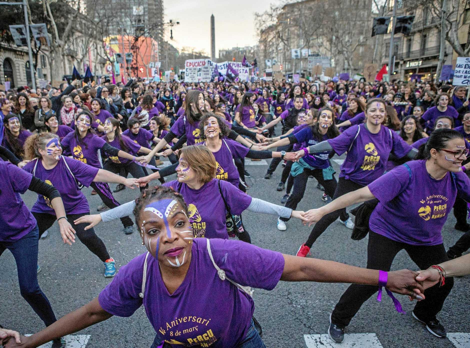 Women take part in a rally on International Women's Day in downtown Barcelona, northeastern Spain.