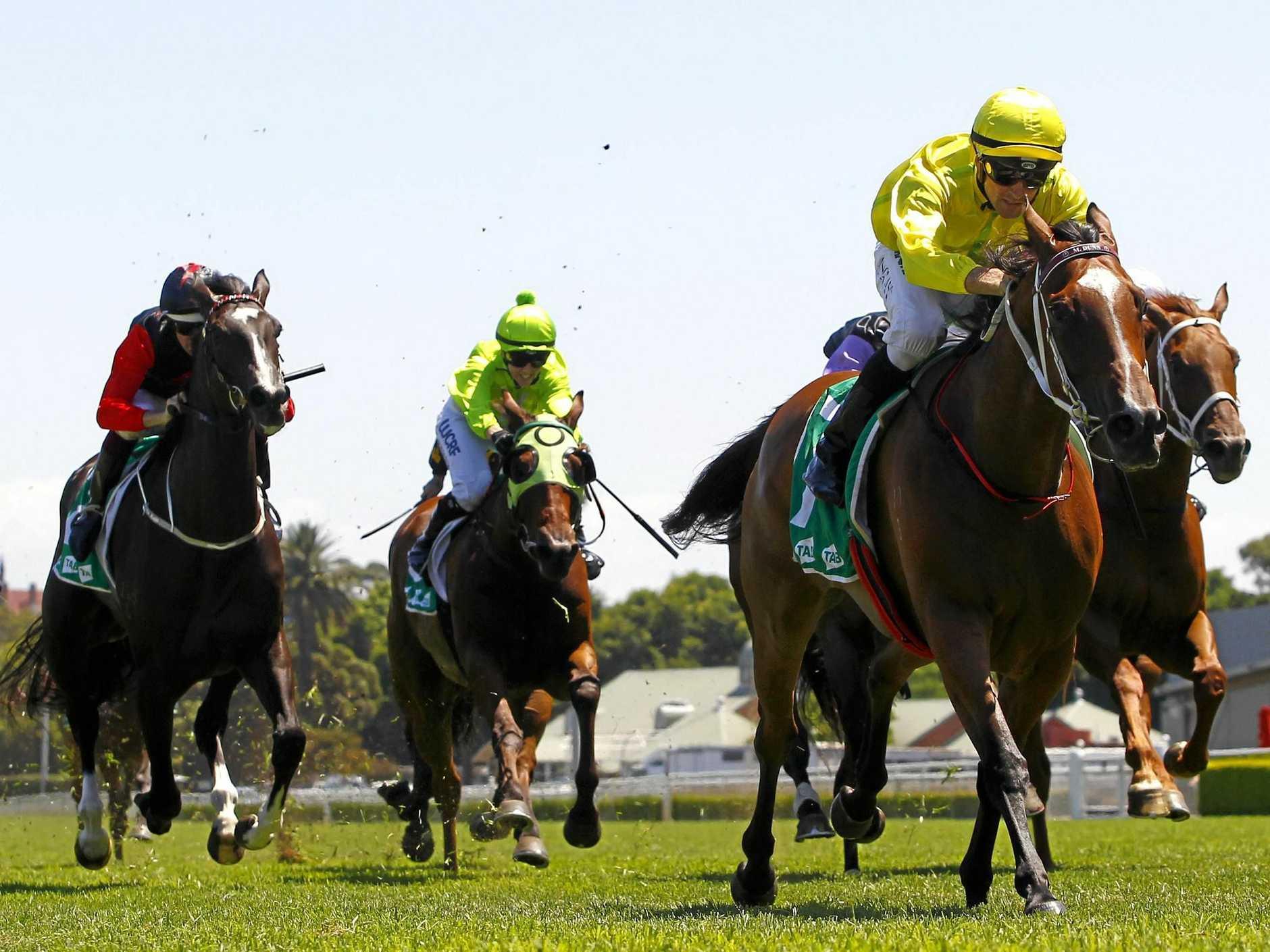 Jockey Tye Angland (right) rides Runway Ready to win the Tab Highway Handicap, during Royal Randwick Race Day at Royal Randwick in Sydney.