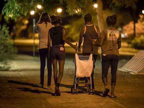 People on the streets after dark in Tennant Creek, Northern Territory.