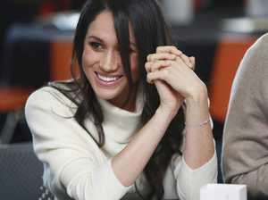 Meghan Markle cracks up