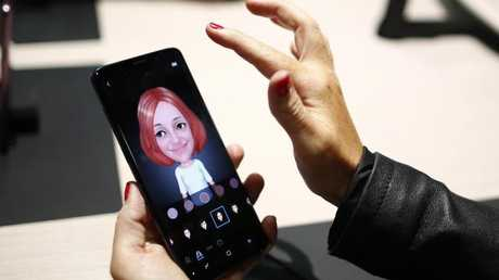 A woman tests Samsung's AR Emoji feature on the Galaxy S9 smartphone. Picture: AP Photo/Manu Fernandez