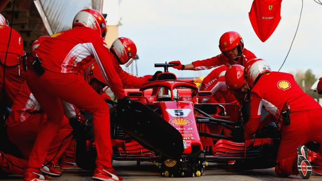 Sebastian Vettel makes a pit stop for new tyres during day three of F1 Winter Testing at Circuit de Catalunya. (Photo by Mark Thompson/Getty Images)