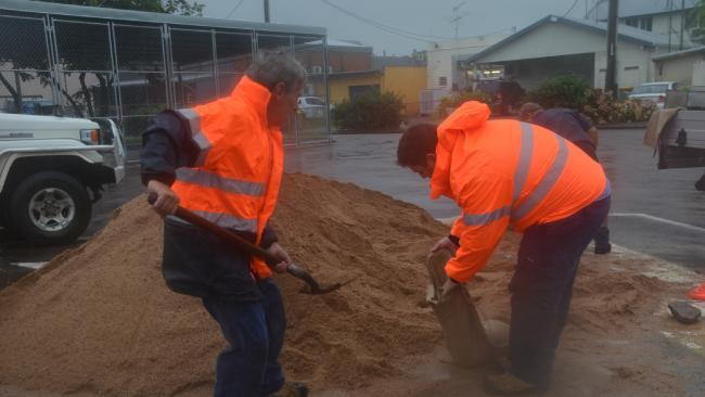 Residents filling up sandbags at the Hinchinbrook Shire Council car park. (Picture: Lillian Altman)